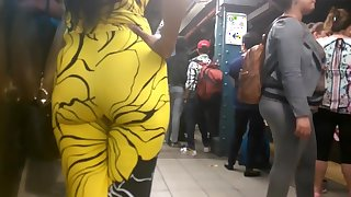 Latina milf bubble booty in yellow jumpsuit