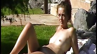 Naked girl in a german sauna garden (11)