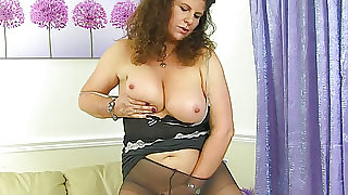 British milf Gilly doesn't wear knickers just tights today