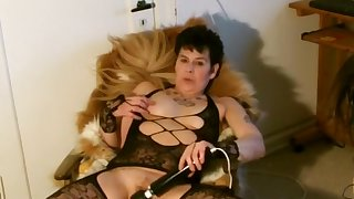 Mature Woman Uses Vibrator In Pussy